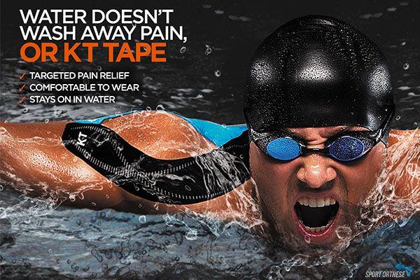 nageur sortant la tête de l'eau avec un strap K Tape sur l'épaule